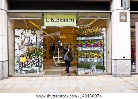 LONDON, UK- MAY 26: Designer LK Bennett's store is decorated with colourful flowers as part of the Chelsea Fringe, celebrating 100 years of the Chelsea Flower Show. May 26, 2013 in London UK. - stock photo