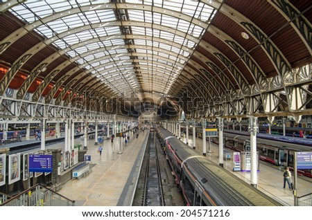 LONDON, UK - MAY 15, 2014:  London terminus for trains from the West of England and Wales - Paddington Station.  Built in Victorian times by Isambard Kingdom Brunel and still a very busy station. - stock photo