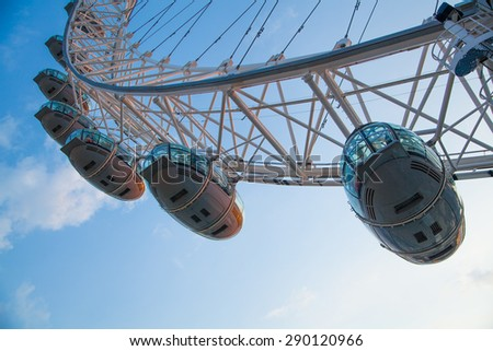 LONDON, UK - MAY 14, 2014 - LONDON, UK - MAY 14, 2014 London eye is a giant Ferris wheel opened on 31 December 1999, the most famous tourist s attraction in centre London - stock photo