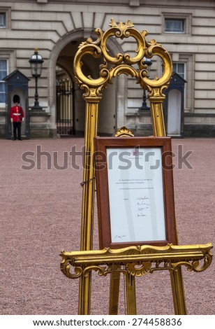 LONDON, UK - MAY 2ND 2015: An easel outside Buckingham Palace containing the official announcement of the birth of William and Catherines second child, on 2nd May 2015. - stock photo