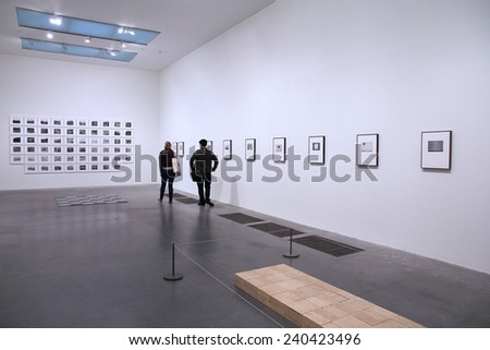 LONDON, UK - MAY 14, 2012: People visit Tate Modern gallery in London. It is the most-visited modern art gallery worldwide, with around 4.7 million visitors per year. - stock photo