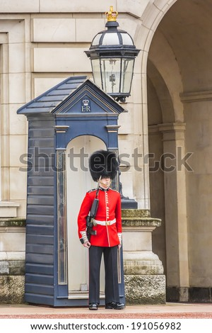 LONDON, UK - MAY 30, 2013: Sentry of the Grenadier Guards posted outside of Buckingham. Grenadier Guards was organized back in 1656.