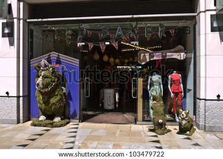 LONDON, UK- MAY 25: Ted Baker's outlet  features corgis in their floral display for the annual Chelsea in Bloom competition, whose theme is the Queen's diamond jubilee. May 25, 2012 in London, UK. - stock photo