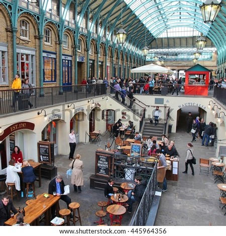 LONDON, UK - MAY 15, 2012: Tourists visit Apple Market in Covent Garden, London. According to TripAdvisor, Camden Town currently is one of top 5 shopping destinations in London. - stock photo