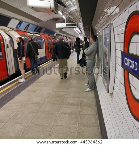LONDON, UK - MAY 15, 2012: Travelers hurry at Oxford Circus underground station in London. London Underground is the 11th busiest metro system worldwide with 1.1 billion annual rides.