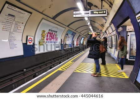 LONDON, UK - MAY 15, 2012: Travelers wait at Camden Town underground station in London. London Underground is the 11th busiest metro system worldwide with 1.1 billion annual rides. - stock photo