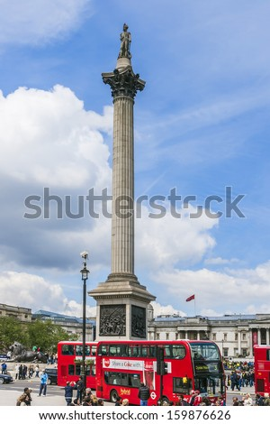 LONDON, UK - MAY 25, 2013 : View of Nelson Column in Trafalgar Square. Monument built to commemorate Admiral Horatio Nelson, who died at Battle of Trafalgar in 1805. - stock photo
