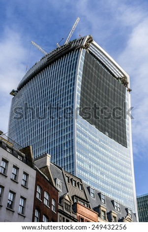LONDON, UK - MAY 25, 2013: View of River Thames and 20 Fenchurch Street - commercial skyscraper under construction. Skyscraper has been nicknamed The Walkie-Talkie because of its distinctive shape.