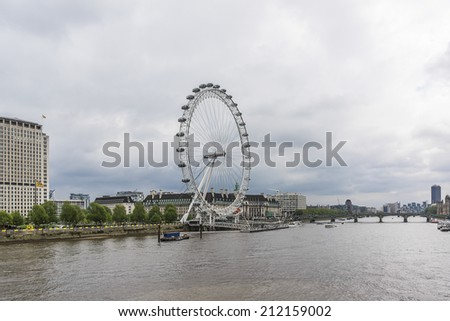 LONDON, UK - MAY 30, 2012: View of the London Eye. London Eye (135 m tall, diameter of 120 m) - a famous tourist attraction over river Thames in the capital city London.