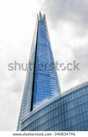 LONDON, UK - MAY 25, 2013: View The Shard (Architect Renzo Piano, 2012) - tallest building in European Union. Glass-clad pyramidal tower (310 m) has 72 habitable floors.