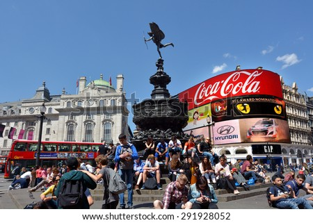 LONDON, UK - MAY 14 2015:Visitors in Piccadilly Circus London, UK.With nearly 100 million tourists visiting Piccadilly each year it one of the most famous intersections in the entire world - stock photo