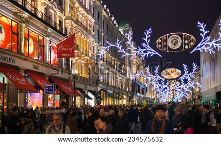 LONDON, UK - NOVEMBER 30, 2014: Black Friday weekend in London the first sale before Christmas. Hamley toy shop on Regent street beautifully decorated with Christmas lights.  - stock photo