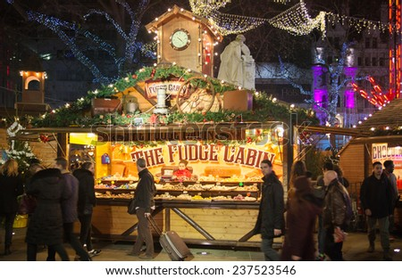 LONDON, UK - NOVEMBER 30, 2014 - Leicester square traditional fun fair with stools, carrousel, prises to win and Christmas activity. People and families enjoying Christmas mood night out