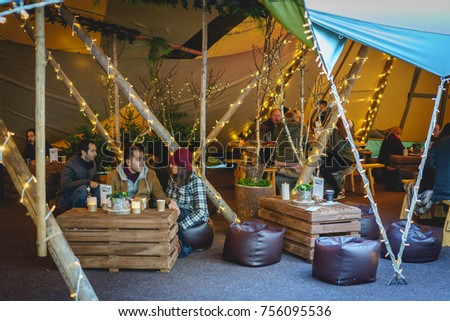 People drinking in a bar and grill tent in & London Uk November 2017 People Drinking Stock Photo 756095539 ...