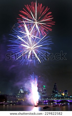 LONDON, UK - NOVEMBER 8TH 2014: A shot of the spectacular firework display marking the finale of the 2014 Lord Mayors Show in London on 8th November 2014. - stock photo