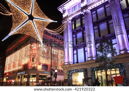 London, UK - November 10, 2011: The Christmas lights decorations outside Marks & Spencer and Selfridges at night, in Oxford Street during the festive season - stock photo