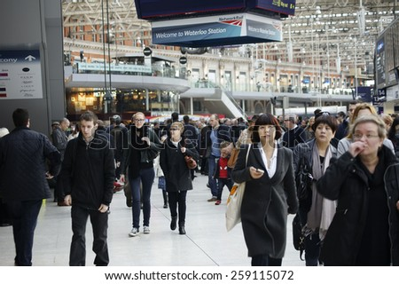 LONDON, UK - NOVEMBER 29: The Interior shot of the train and subway station Waterloo with strangers and travelers on November 29, 2014 in London / Waterloo Station              - stock photo