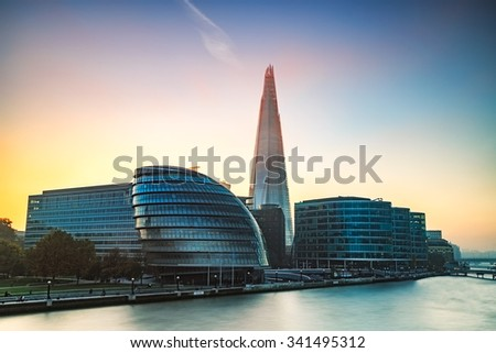 LONDON, UK - NOVEMBER 08, 2015 : The Shard and urban architecture at sunset on November in London, UK. the Shard is currently the tallest building in the European Union. - stock photo