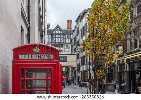 LONDON, UK - NOVEMBER 5, 2014 : Traditional type K6 phone kiosk in Kingly Street, just off Regent Street in central London. The famous Liberty Department Store building is visible in the background. - stock photo
