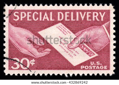 London, UK, November 27 2010 - Vintage 1954-1957 United States of America cancelled postage stamp with an engraving of a postal worker delivering a special delivery envelope - stock photo
