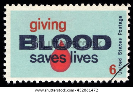 London, UK, November 27 2010 - Vintage 1971 United States of America cancelled postage stamp with information to Americans that giving blood saves lives