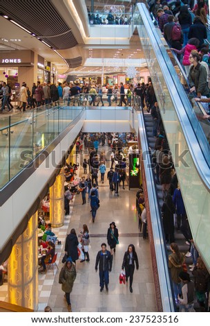 LONDON, UK - NOVEMBER 29, 2014:  Westfield Stratford City Shopping centre  with lots of people rushing for Christmas sale.  - stock photo