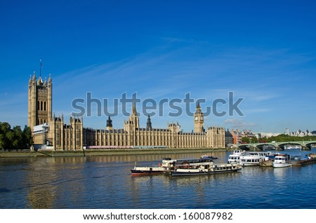 LONDON, UK - OCT 24:  Boats moored in front of the Houses of Parliament, London, Uk on Oct 24, 2013.  To the right, Portcullis House and Westminster Bridge can also be seen.