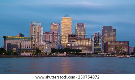 LONDON, UK - OCTOBER 17, 2014: Canary Wharf business and banking district night lights - stock photo