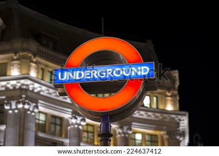 LONDON, UK - OCTOBER 11: Close up of a illuminated station signs for the London Underground transportation systems at night on oct 11 2014 in London, United Kingdom, Europe