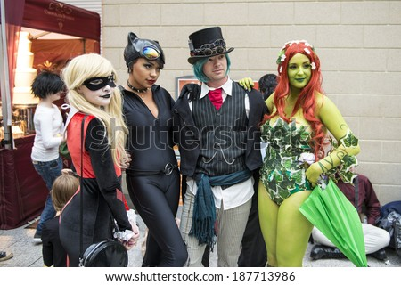 LONDON, UK - OCTOBER 26: Cosplayers dressed as a  Harley Quinn, Catwoman and Poison Ivy from Batman for the Comicon at the Excel Centre's MCM Expo. October 26, 2013 in London. - stock photo