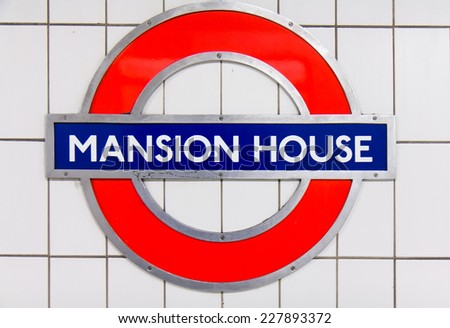 LONDON, UK - 18 OCTOBER , 2014: Metro station sign Mansion house on the circle and district line in London, UK, October 18, 2014. - stock photo