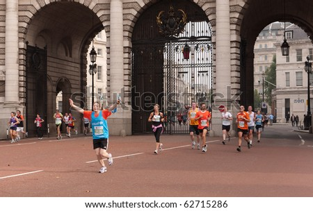 LONDON,UK- OCTOBER 10: One Runner in the Royal Parks Foundation Half Marathon, Raises His Hands After Running Through Admiralty Arch. October 10 2010 in London. - stock photo