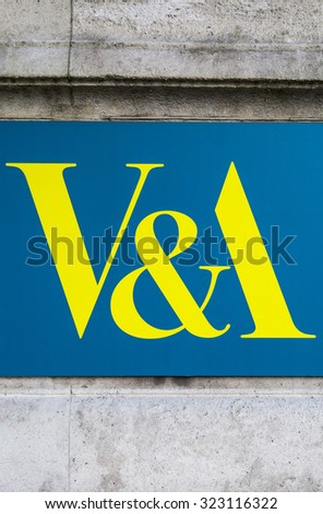 LONDON, UK - OCTOBER 1ST 2015: A close-up of The Victoria and Albert Museum logo located on the exterior of the building in London, on 1st October 2015. - stock photo