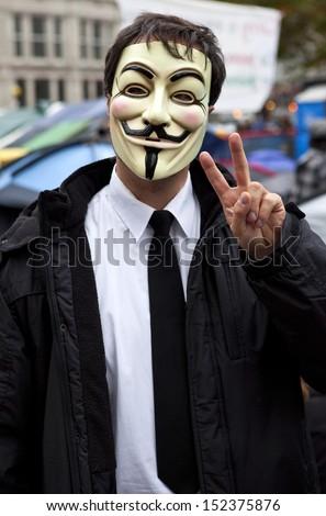 LONDON, UK - OCTOBER 30TH 2011: A masked protestor at the Occupy London camp outside St. Paul's Cathedral in London on 30th October 2011. - stock photo