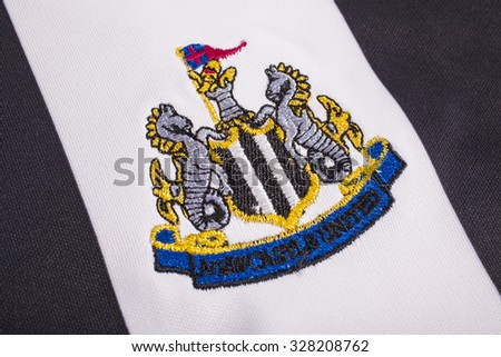 LONDON, UK - OCTOBER 15TH 2015: The club crest on a Newcastle United FC shirt, on 15th October 2015. - stock photo