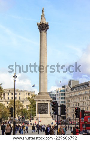 LONDON, UK - OCTOBER 17, 2014: Tourists visit Trafalgar Square October 17, 2014 in London. One of the most popular tourist attraction on Earth it has more than fifteen million visitors a year.  - stock photo