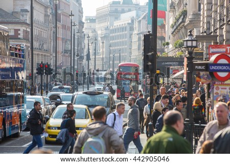 LONDON, UK - OCTOBER 4, 2015: Underground entrance at the Regent street and lots of people and cars on the road  - stock photo