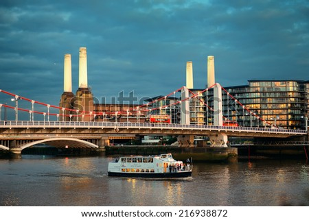 LONDON, UK - SEP 27: Battersea Power Station and bridge in Thames River on September 27, 2013 in London, UK. London is the world's most visited city and the capital of UK. - stock photo