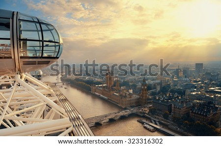 LONDON, UK - SEP 26: London Eye over Thames River on September 26, 2013 in London, UK. It is Europe's tallest Ferris wheel and the most popular paid tourist attraction in UK - stock photo