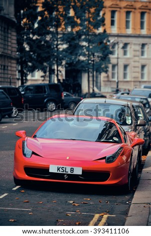 LONDON, UK - SEP 27: Red porsche and London Street view on September 27, 2013 in London, UK. London is the world's most visited city and the capital of UK. - stock photo