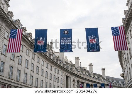 LONDON, UK - SEPTEMBER 27: American flag and NFL banners hanging above in Regent street. September 27, 2014 in London. Regent street was closed to traffic to host NFL related games and events. - stock photo