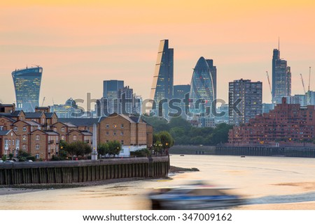 LONDON, UK - SEPTEMBER 9, 2015:  City of London business and banking aria at sunset. Panoramic view - stock photo