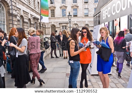 LONDON, UK-SEPTEMBER 14: Fashionable visitors and fashion industry members at the internationally famous London'Fashion Week at Somerset House. September 14, 2012 in London UK - stock photo