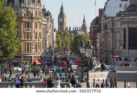 LONDON, UK - SEPTEMBER 10, 2015: Lots of people and tourists on the Trafalgar square in hot summer day. View includes Big Ben at the background - stock photo