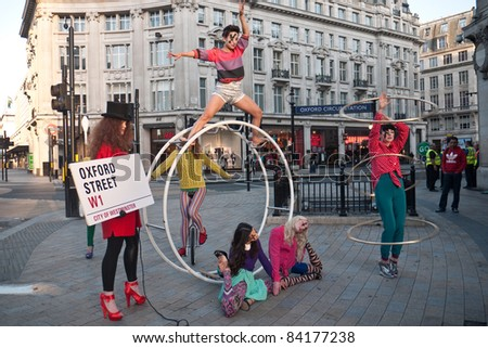 LONDON, UK-SEPTEMBER 5: Oxford Street's High Street Fashion Week launched with a circus themed fashion shoot at the iconic Oxford Circus,  ahead of London Fashion Week. September 5, 2011 in London UK - stock photo