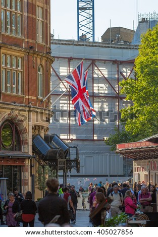 LONDON, UK - SEPTEMBER 10, 2015: People, tourists and Londoners walking on London's street