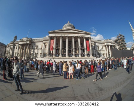 LONDON, UK - SEPTEMBER 27, 2015: Tourists in Trafalgar Square in front of the National Gallery