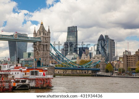 LONDON, UK - SEPTEMBER 19, 2015: Tower bridge and City of London. View includes Gherkin and other buildings at the background