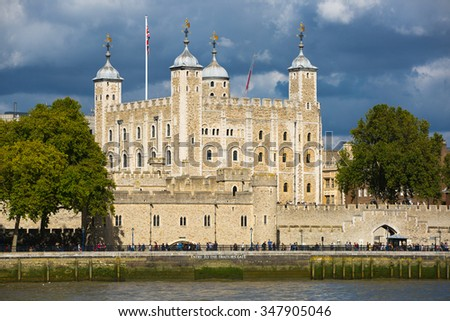 LONDON UK - SEPTEMBER 19, 2015 - Tower of London, River Thames and people walking by embankment