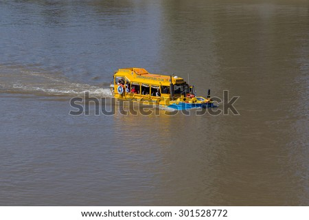 LONDON, UK - 18TH JULY 2015: A London Duck Tour boat in the River Thames during the day. People can be seen on the boat. - stock photo